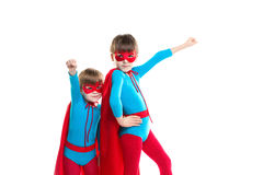 Two boys playing in a superhero . Royalty Free Stock Image