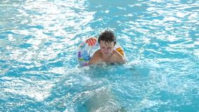 Two Boys Playing In The Swimming Pool stock video footage