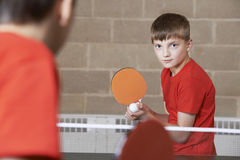 Two Boys Playing Table Tennis Match In School Gym Royalty Free Stock Images