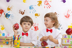 Two boys are playing together stock images