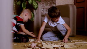 Two boys playing with toys is building a house. Two boys playing with toys  is building a house stock video