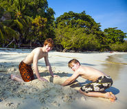 Two boys are playing at a tropical beach in Thailand Royalty Free Stock Image