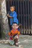 Two boys. Playing in village Ma Au in Bagan ,Myanmar (Burma Stock Images