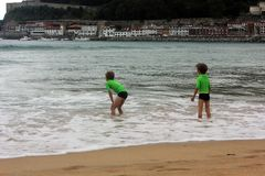 Two boys playing in the water stock photo