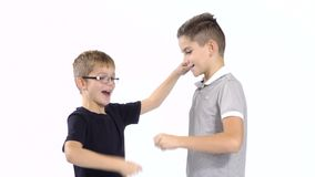 Two boys plays in paper, scissors, rock at white background stock video