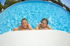 Two boys in a pool. Enjoy their summer vacation Royalty Free Stock Image