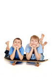 Two boys posing on a skateboard Royalty Free Stock Photo