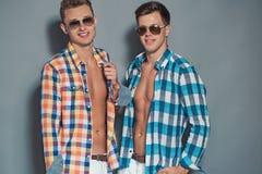 Two boys posing in studio Royalty Free Stock Photos