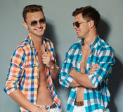 Two boys posing in studio. Two beautiful guys in summer clothes portraits in studio Royalty Free Stock Images
