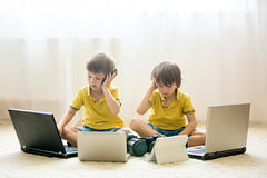 Two boys, preschool children, having fun playing at home with co Stock Photography