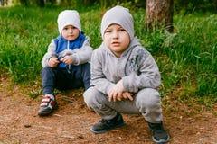 Two boys preschooler outdoors royalty free stock photography