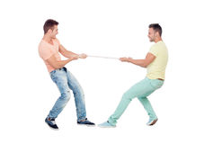 Two boys pulling a rope. Isolated on a white background Royalty Free Stock Images