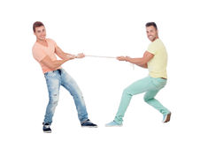 Two boys pulling a rope. Isolated on a white background Stock Images