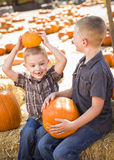 Two Boys at the Pumpkin Patch Talking and Having Fun Royalty Free Stock Photo
