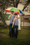Two boys with rainbow umbrella in park Royalty Free Stock Photography