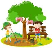 Two boys raking leaves in garden Stock Photos