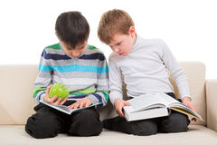 Two boys reading big book. Two happy boys reading big book solated on white background Royalty Free Stock Photos