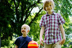 Two boys ready to play ball. Two boys in park ready to play ball Royalty Free Stock Photos