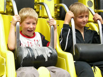 Two boys is redy to go. With the roundabout Royalty Free Stock Photos