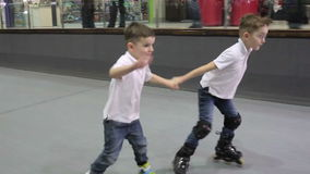 Two boys ride on the rollers on rollerdrome stock video