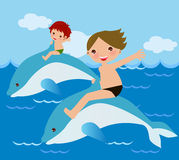 Two boys rides dolphin Royalty Free Stock Image