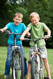 Two Boys Riding Bikes Together Royalty Free Stock Image