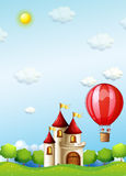 Two boys riding in a hot air balloon near the castle Stock Image