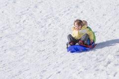 Two boys riding sledge Royalty Free Stock Image