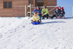 Two boys riding on sledge Stock Photography