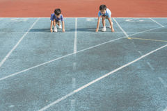 Two boys run on track Royalty Free Stock Photography