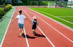 Two Boys Running Royalty Free Stock Images