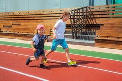 Two Boys Running Stock Photo