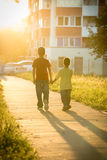 Two boys running together on street Royalty Free Stock Images