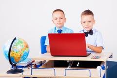 Two boys school computer desk globe. Education Stock Photography