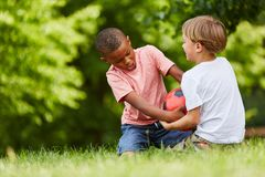 Two boys scuffle for soccer ball Royalty Free Stock Photography