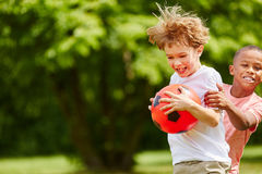 Two boys scuffle during soccer match Royalty Free Stock Images