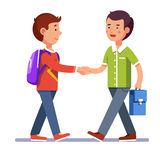 Two boys shaking hands making peace Stock Image