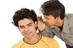 Two boys sharing funny secrets Royalty Free Stock Photography