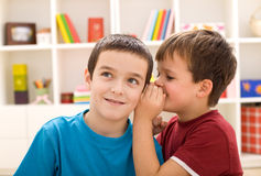 Two boys sharing a secret Royalty Free Stock Image