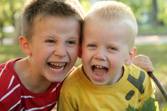 Two boys are shouting Stock Photos