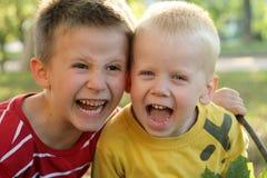 Two boys are shouting stock photos