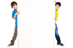 Two boys showing new blank advertising Royalty Free Stock Images