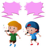 Two boys singing song on microphone Stock Photos