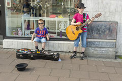 Two boys singing a song on street in Reykjavik. Stock Photo