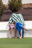 Two boys sitting on a bench at the pool Royalty Free Stock Image