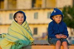 Two boys sitting and looking at sunrise Royalty Free Stock Image