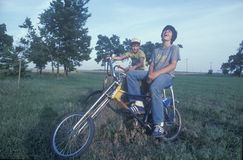 Two boys sitting on their bikes. Laughing in Cambria, KS Stock Image