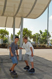 Two boys skateboarding. Stock Image