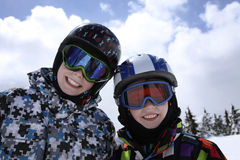 Two boys skiing Stock Photos