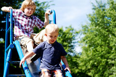 Two boys on slide Royalty Free Stock Images